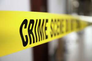 Crime scene tape in building with blurred background