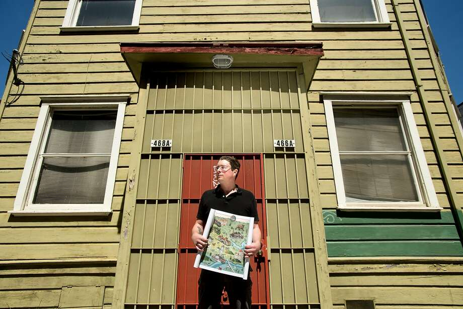 Liam O'Donoghue holds the Long Lost Oakland project's map. Photo: Noah Berger / Special To The Chronicle