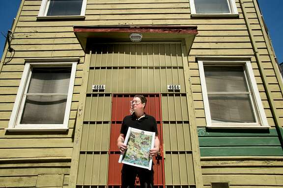 Liam O'Donoghue, who's Long Lost Oakland project recalls buildings, plants and wild animals from Oakland's past, stands with a map on Friday, April 13, 2018, in Oakland, Calif.