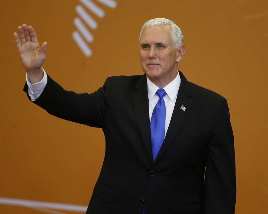 U.S. Vice President Mike Pence greets participants at the Summit of the Americas in Lima, Peru. Photo: Karel Navarro / Associated Press