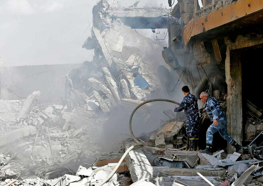 Syrian soldiers inspect the wreckage of a building described as part of the Scientific Studies and Research Centre (SSRC) compound in the Barzeh district, north of Damascus. Photo: LOUAI BESHARA, AFP/Getty Images