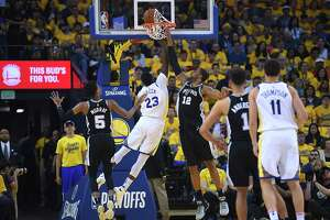 OAKLAND, CA - APRIL 14:  LaMarcus Aldridge #12 of the San Antonio Spurs blocks the shot of Draymond Green #23 of the Golden State Warriors in the first quarter during Game One of the first round of the 2018 NBA Playoff at ORACLE Arena on April 14, 2018 in Oakland, California. NOTE TO USER: User expressly acknowledges and agrees that, by downloading and or using this photograph, User is consenting to the terms and conditions of the Getty Images License Agreement.