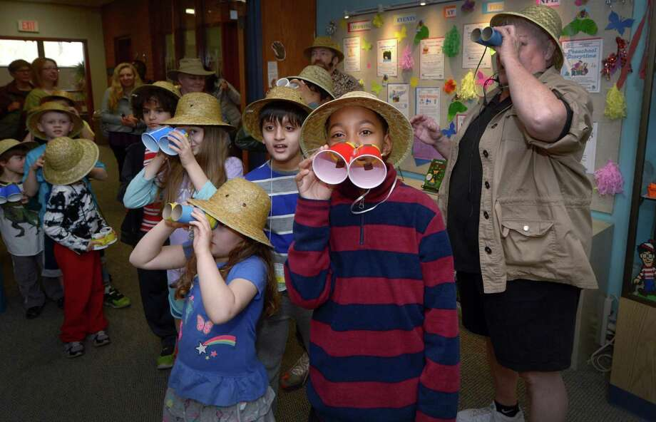 Children including Om Padhiyar, 10, and  Emir Walker, 9, take part in A Drumming Safari Scavenger Hunt at the Norwalk Library main branch Friday, April 14, 2018, where the kids age six to nine drum and learn about animals as they follow a safari tour throughout the library in Norwalk, Conn. Photo: Erik Trautmann / Hearst Connecticut Media / Norwalk Hour