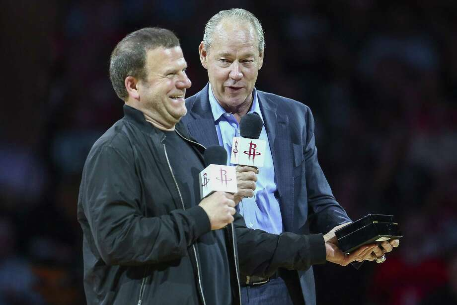 Houston Astros owner Jim Crane, right, gives Houston Rockets owner Tilman Fertitta a World Series ring as the Houston Rockets take on the Portland Trail Blazers at the Toyota Center Thursday, April 5, 2018 in Houston. (Michael Ciaglo / Houston Chronicle) Photo: Michael Ciaglo, Houston Chronicle / Houston Chronicle / Michael Ciaglo