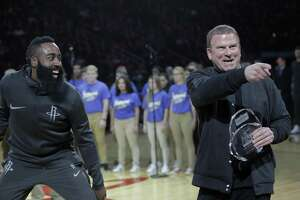 Houston Rockets owner Tilman Fertitta and  guard James Harden (13) joke around after an award presentation before the Houston Rockets and San Antonio Spurs game at the Toyota Center on Friday, Dec. 15, 2017, in Houston. ( Elizabeth Conley / Houston Chronicle )