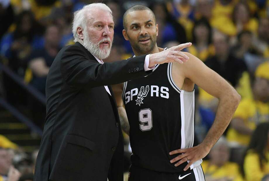 OAKLAND, CA - APRIL 14:  Head coach Gregg Popovich of the San Antonio Spurs talks with his player Tony Parker #9 against the Golden State Warriors in the second quarter during Game One of the first round of the 2018 NBA Playoff at ORACLE Arena on April 14, 2018 in Oakland, California. NOTE TO USER: User expressly acknowledges and agrees that, by downloading and or using this photograph, User is consenting to the terms and conditions of the Getty Images License Agreement. Photo: Thearon W. Henderson, Getty Images / 2018 Getty Images