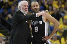 OAKLAND, CA - APRIL 14:  Head coach Gregg Popovich of the San Antonio Spurs talks with his player Tony Parker #9 against the Golden State Warriors in the second quarter during Game One of the first round of the 2018 NBA Playoff at ORACLE Arena on April 14, 2018 in Oakland, California. NOTE TO USER: User expressly acknowledges and agrees that, by downloading and or using this photograph, User is consenting to the terms and conditions of the Getty Images License Agreement.
