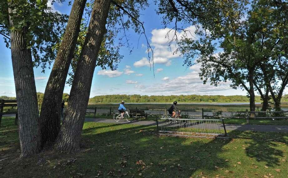 Cyclists enjoy an autumn ride along the Mohawk Hudson Bikeway Thursday afternoon, Sept. 26, 2013, in Niskayuna, N.Y. (Lori Van Buren / Times Union) Photo: Lori Van Buren