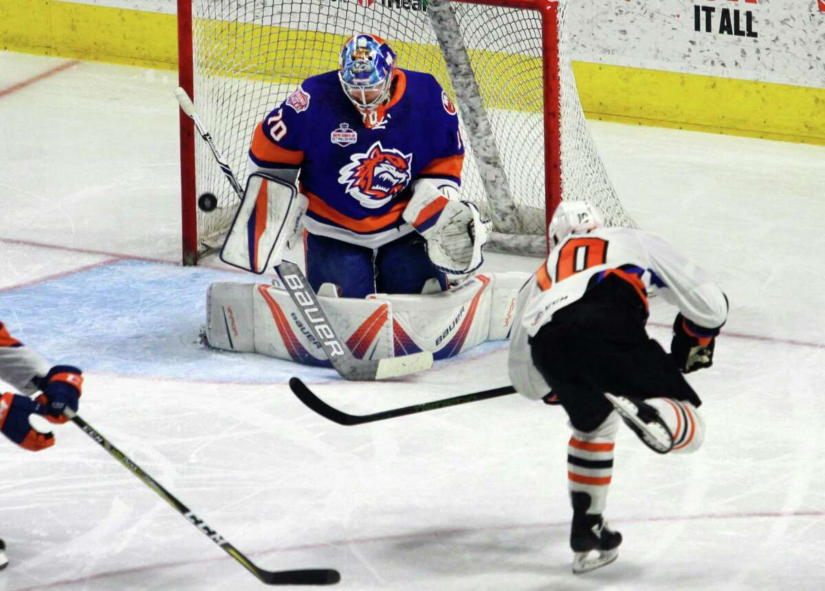 Sound Tigers goalie Kristers Gudlevskis fails to stop a shot by Lehigh Valley's Greg Carey during AHL hockey action at the Webster Bank Arena in Bridgeport, Conn. on Saturday Mar. 10, 2018.