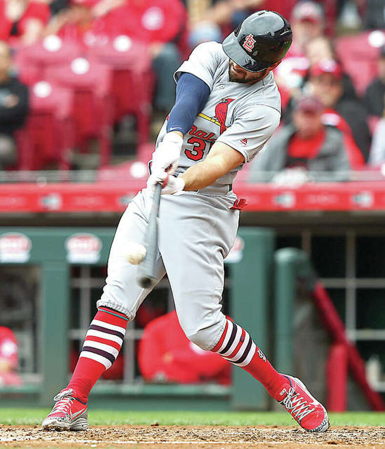 The Cardinals' Greg Garcia hits a home run in the fourth inning in Saturday's win over the Reds in Cincinnati. Photo:       AP