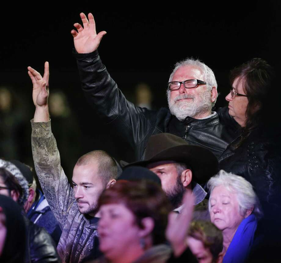 Stephen Willeford (top right) becomes emotional as he joins in prayer with the First Baptist Church families as Vice-president Mike Pence makes remarks at Floresville High School to pay respects to the victims of Sunday's church shooting at First Baptist Church in Sutherland Springs, Texas on Wednesday, Nov. 8, 2017. (Kin Man Hui/San Antonio Express-News) Photo: Kin Man Hui,  Staff / San Antonio Express-News / ©2017 San Antonio Express-News