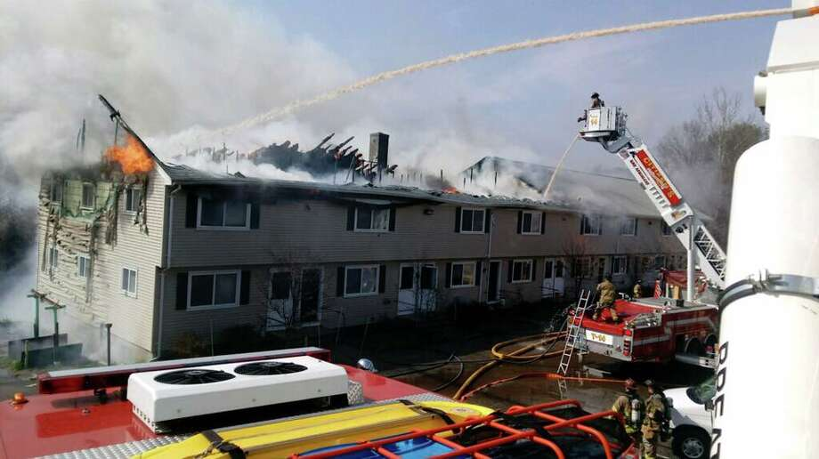 Firefighters are working to extinguish a fire in town Saturday, April 14, according to fire officials. Photo: Courtesy Of Jeff Platek