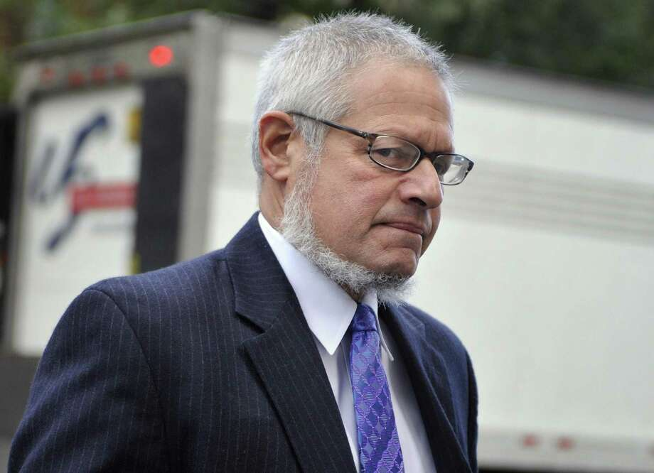 Attorney Thomas Ullmann, Public Defender for Steven Hayes, arrives at Superior Court for the first day of the penalty phase of the trial of 47-year-old Steven Hayes in New Haven, Conn., on Monday, Oct. 18, 2010.  Hayes was convicted of 16 counts for the 2007 killings in Cheshire.  (AP Photo/Jessica Hill) Photo: Jessica Hill / ST / AP2010