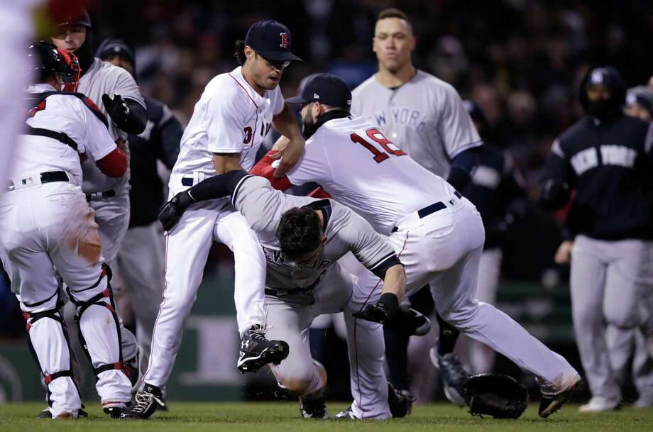 Red Sox pitcher Joe Kelly, left, and first baseman Mitch Moreland, right drop the Yankees' Tyler Austin, center, to the grass during a fight on Wednesday at Fenway Park. Photo: Charles Krupa / Associated Press / Copyright 2018 The Associated Press. All rights reserved.