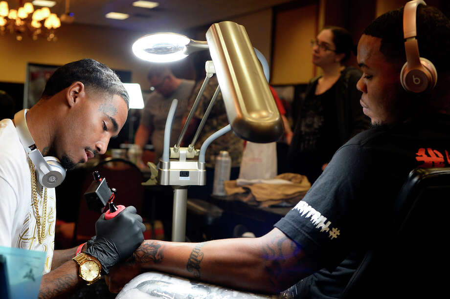 Joshua Benard tattoos client Donaldson Thomas at the Ink Masters Tattoo Show at the MCM Elegante Hotel. The show will continue today.  Photo taken Saturday 4/14/18 Ryan Pelham/The Enterprise Photo: Ryan Pelham / ©2018 The Beaumont Enterprise/Ryan Pelham