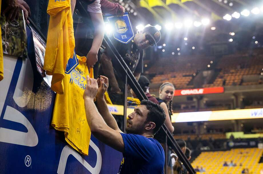 Warriors' Zaza Pachulia (27) signs autographs for fans before the Golden State Warriors and San Antonio Spurs face off during the first game of the NBA playoffs at Oracle Arena Saturday, April 14, 2018 in Oakland, Calif. Saturday, April 14, 2018 in Oakland, Calif. Photo: Jessica Christian / The Chronicle