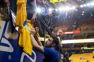 Warriors� Zaza Pachulia (27) signs autographs for fans before the Golden State Warriors and San Antonio Spurs face off during the first game of the NBA playoffs at Oracle Arena Saturday, April 14, 2018 in Oakland, Calif. Saturday, April 14, 2018 in Oakland, Calif.