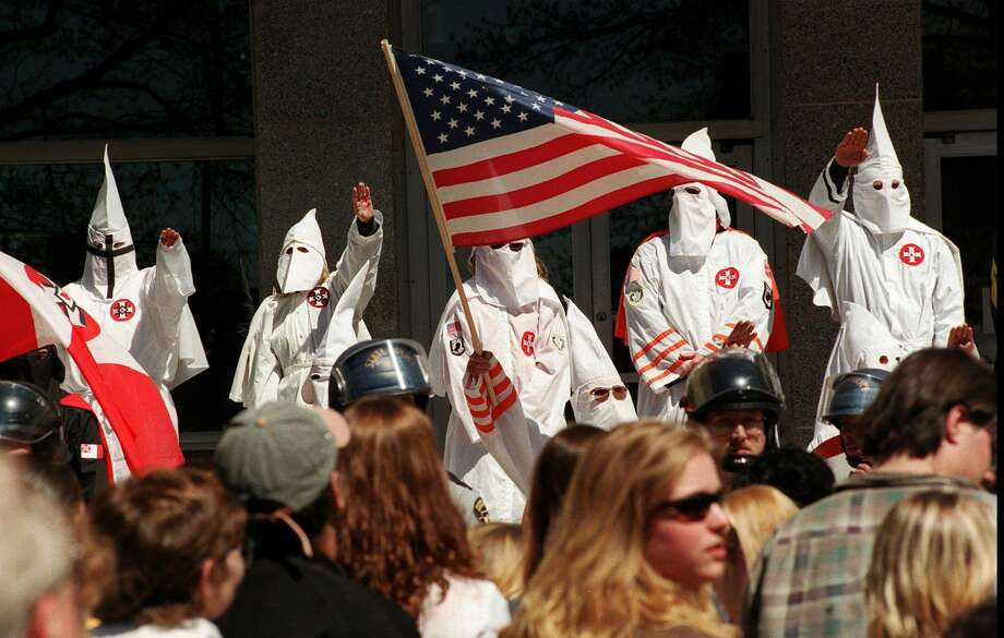 Restricting membership to white Christians, the Klan picked selective scriptures from the Bible to preach white supremacy. Photo: MICHAEL FERNANDEZ, MBR / AP / PATRIOT NEWS