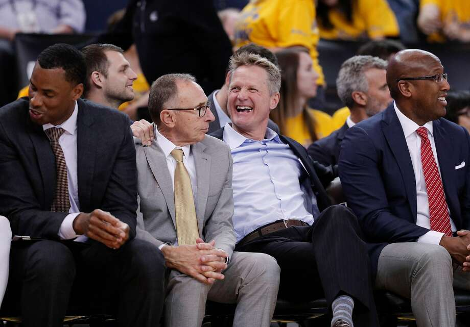 Warriors head coach Steve Kerr (without a tie) and assistants Jarron Collins (left), Nick U'ren (rear), Ron Adams and Mike Brown had much to enjoy in Game 1. Photo: Carlos Avila Gonzalez / The Chronicle