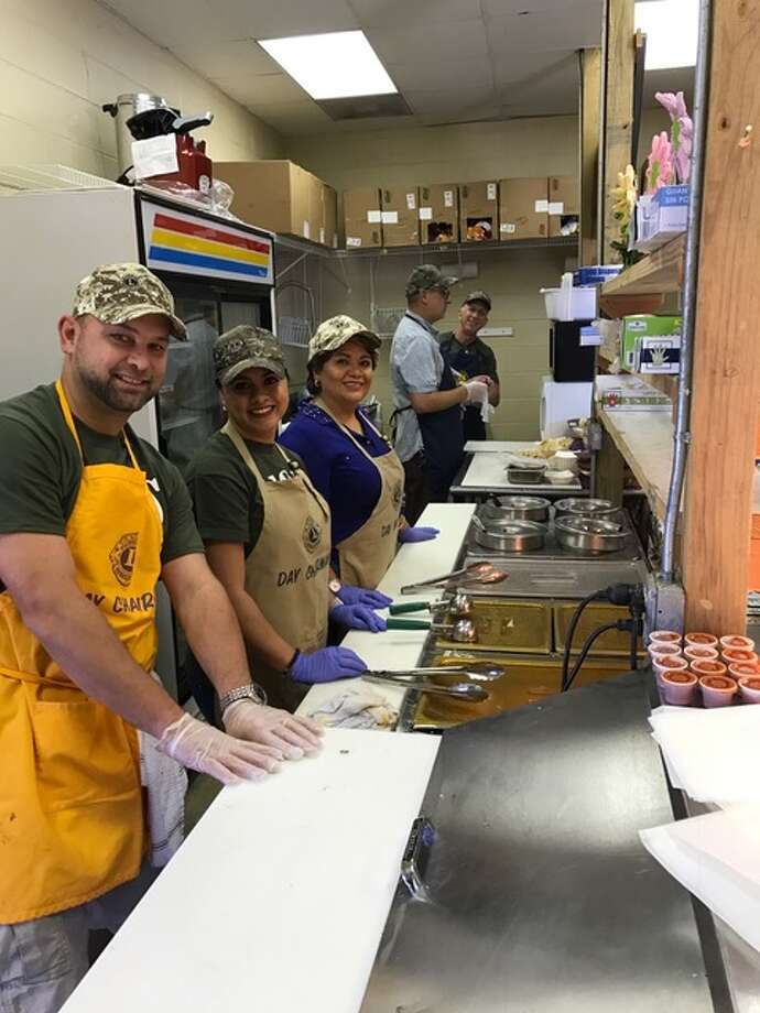 Club members Jason Miller, Lorena Garcia, Delma Landaverde, Brett Rohloff, and John Kreger are lined up and ready to serve customers at the Conroe Noon Lions Club concession stand during the Montgomery County Fair.