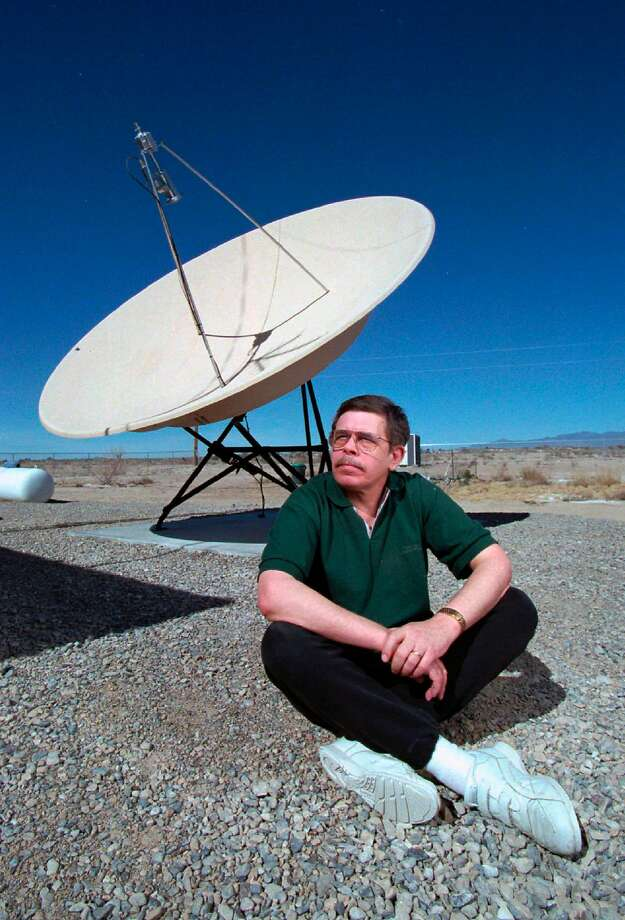 "In this March 7, 1997, photo, shows late night talk show host Art Bell near a satellite dish at his Pahrump, Nev., home. Bell, was the original owner of Pahrump based radio station KNYE 95.1 FM. And perhaps best known for his conspiracy theory in the paranormal, with his radio show ""Coast to Coast,"" which was syndicated across the nation. The Nye County Sheriff's Office says Bell died at his home in Pahrump, Nev. Bell is scheduled for an autopsy later this week to determine the cause of death. He was 72. (Aaron Mayes/Las Vegas Sun via AP) Photo: Aaron Mayes, Associated Press"