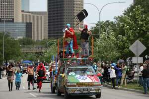 """The """"Luchamobile"""" art car participates in the 31st Annual Houston Art Car Parade on Allen Parkway on Saturday, April 14, 2018, in Houston. More than 250 art cars participated in this year's parade."""