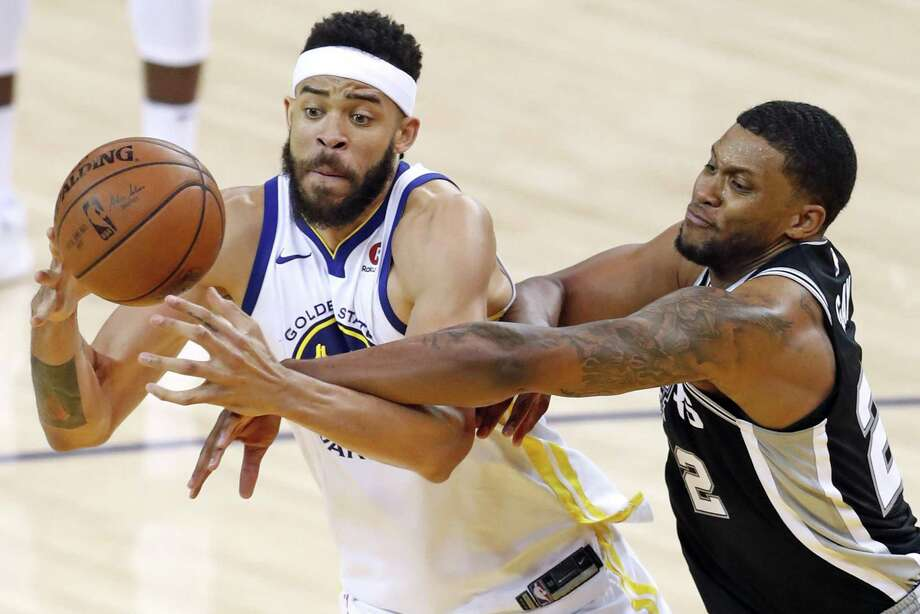 Golden State Warriors' JaVale McGee is fouled by San Antonio Spurs' Rudy gay in 3rd quarter during Warriors' 113-92 win in Game 1 of NBA Western Conference First Round playoff game at Oracle Arena in Oakland, Calif., on Saturday, April 14, 2018. Photo: Scott Strazzante, Staff Photographer / The Chronicle / San Francisco Chronicle
