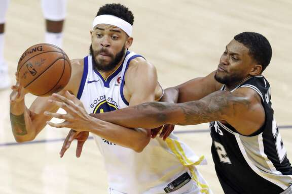 Golden State Warriors' JaVale McGee is fouled by San Antonio Spurs' Rudy gay in 3rd quarter during Warriors' 113-92 win in Game 1 of NBA Western Conference First Round playoff game at Oracle Arena in Oakland, Calif., on Saturday, April 14, 2018.