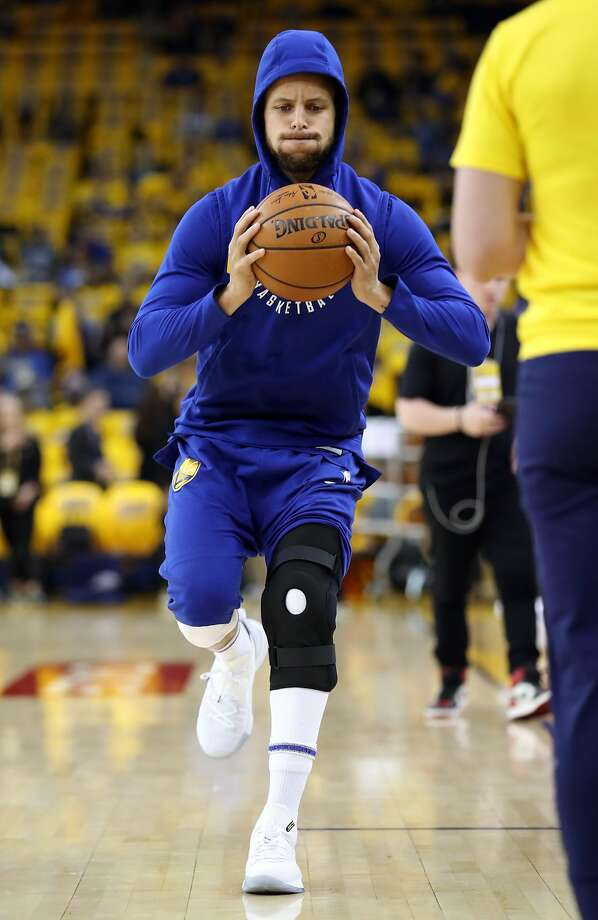 Stephen Curry is shown wearing a large knee brace before Saturday's game. Photo: Scott Strazzante / The Chronicle