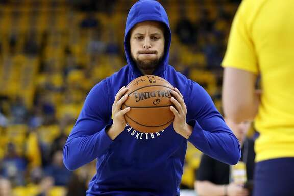 Golden State Warriors' Stephen Curry works on rehabilitating his knee injury before Warriors play San Antonio Spurs in Game 1 of NBA Western Conference First Round playoff game at Oracle Arena in Oakland, Calif., on Saturday, April 14, 2018.