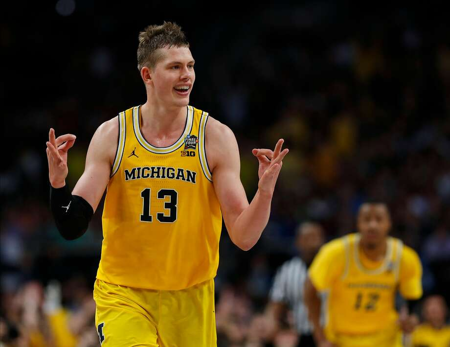 Michigan forward Moritz Wagner, who is from Germany, says he wants to play against his idol , Dirk Nowitski, in the NBA. Photo: Charlie Neibergall / Associated Press