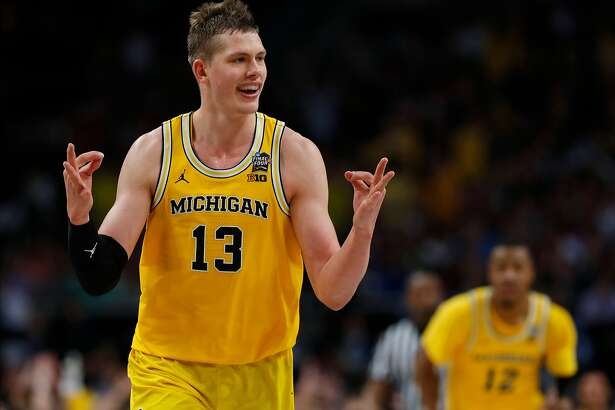 Michigan's Moritz Wagner (13) reacts after scoring a 3-point shot against Loyola-Chicago during the second half in the semifinals of the Final Four NCAA college basketball tournament, Saturday, March 31, 2018, in San Antonio. (AP Photo/Charlie Neibergall)