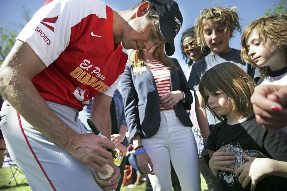 Kids get baseballs autographed by the candidate as Beto O'Rourke plays baseball with his old team Los Diablitos at a fundraiser for his campaign for U.S. Senate on April 14, 2018.  Two brothers, Roman (center) and Jude Pelagrin, take advantage of the opportunity. Photo: Tom Reel, Staff / San Antonio Express-News / 2017 SAN ANTONIO EXPRESS-NEWS