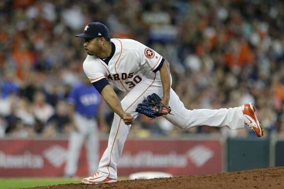 Houston Astros Hector Rondon pitches against the Texas Rangers during the seventh inning of game at Minute Maid Park Saturday, April 14, 2018, in Houston. ( Melissa Phillip / Houston Chronicle )