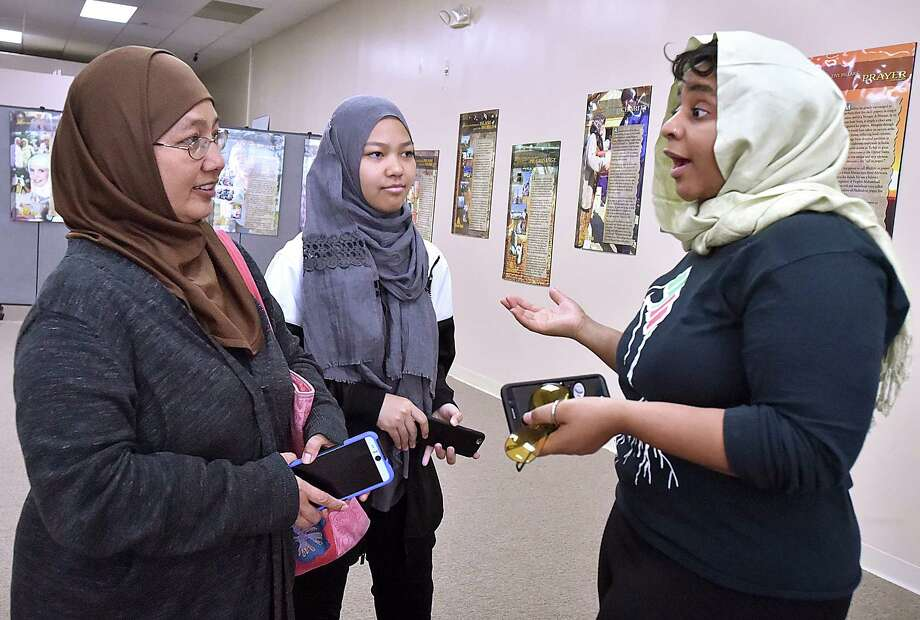 "LaQuisha Gill, at right, talks with Muslims Anna Hanafi and her 14-year-old daughter Aisya, of West Haven at the first 'Meet your Muslim neighbor' at the New Haven Islamic Center at 254 Bull Hill Lane in Orange, Saturday, April 14, 2018. All non-Muslim women, such as Gill, wore hijabs per a request from the NHIC to show respect of the Islamic faith. Gill said, ""I've been to a handful of these events and feel it is important to build an interfaith relationship."" Photo: Catherine Avalone, Hearst Connecticut Media / New Haven Register"