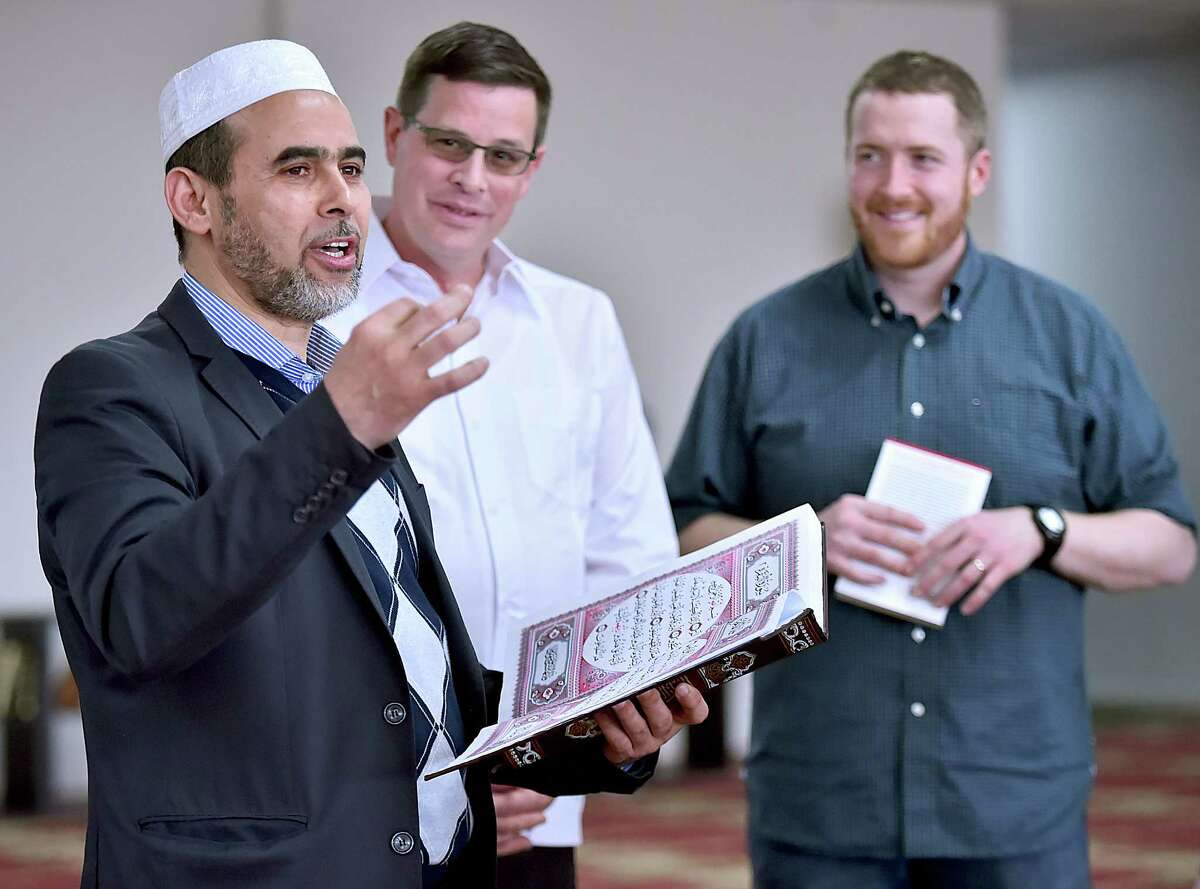 Islamic scholar Bachir Djehiche talks about the similarities between Muslim and Christianity as he reads from the Quran at the 'Meet your Muslim neighbor' at the New Haven Islamic Center at 254 Bull Hill Lane in Orange, Saturday, April 14, 2018. In the background is Pastor Jim Detweiler of Hope Christian Church in North Haven and Pastor Patrick Dunn of Elm City Vineyard Church in New Haven. The outreach program is an effort to build alliances and create friendships in the community.