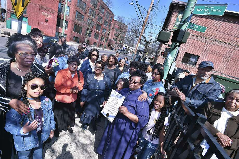 Surrounded by congregants of the Christian Love Center, Pastor Willie Mae Clayton, founder of the non-denominational Christian church at 154 Derby Ave. in New Haven holds a proclamation from the city of New Haven Board of Alders designating the corner at Derby Avenue and Mead Street as the Overseer Willie May Clayton Corner, Saturday, April 14, 2018. Photo: Catherine Avalone / Hearst Connecticut Media / New Haven Register