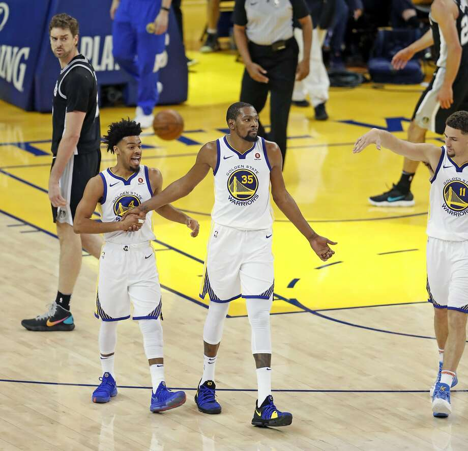 Golden State Warriors' Quinn Cook, Kevin Durant and Klay Thompson celebrate as San Antonio Spurs' Paul Gasol walks off the court during 3rd quarter of Warriors' 113-92 win in Game 1 of NBA Western Conference First Round playoff game at Oracle Arena in Oakland, Calif., on Saturday, April 14, 2018. Photo: Scott Strazzante / The Chronicle