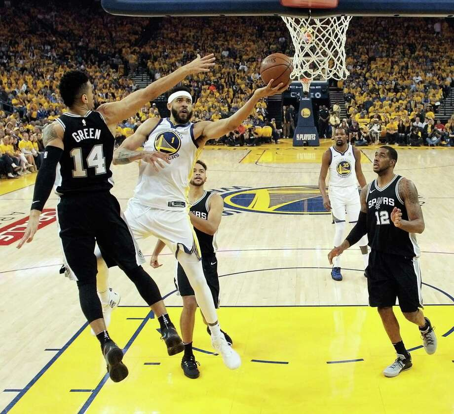 JaVale McGee drives to the rim in his surprise start in Game 1 against the Spurs. McGee scored a season-high 15 points and helped limit the Spurs' LaMarcus Aldridge (right) to 14 points. Photo: Carlos Avila Gonzalez / San Francisco Chronicle / San Francisco Chronicle/Carlos Avila Gonzalez