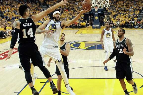 JaVale McGee drives to the rim in his surprise start in Game 1 against the Spurs. McGee scored a season-high 15 points and helped limit the Spurs' LaMarcus Aldridge (right) to 14 points.