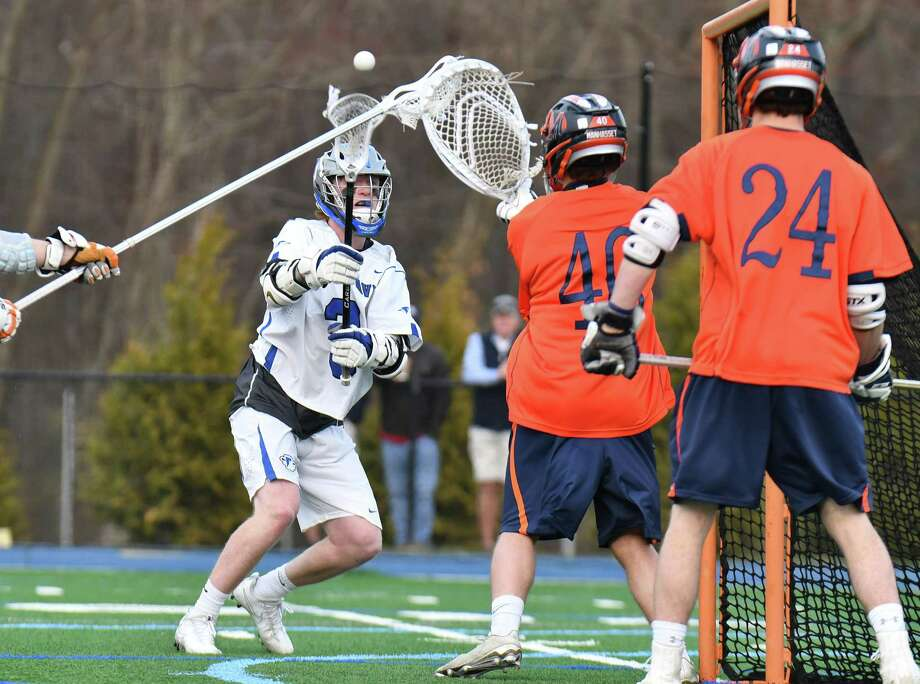 Darien's Hudson Pokorny shoots and scores during the Blue Wave's 7-6 victory over Manhassett (N.Y.) on Saturday in Darien. Photo: Gregory Vasil / For Hearst Connecticut Media / Connecticut Post Freelance