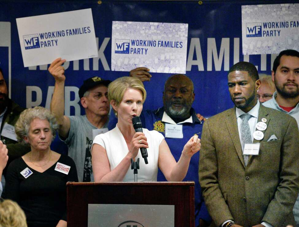 Cynthia Nixon, center, and Jumaane Williams, right, receive the Working Families Party endorsement for governor and lieutenant governor at their conference Saturday April 14, 2017 in Albany, NY. (John Carl D'Annibale/Times Union)