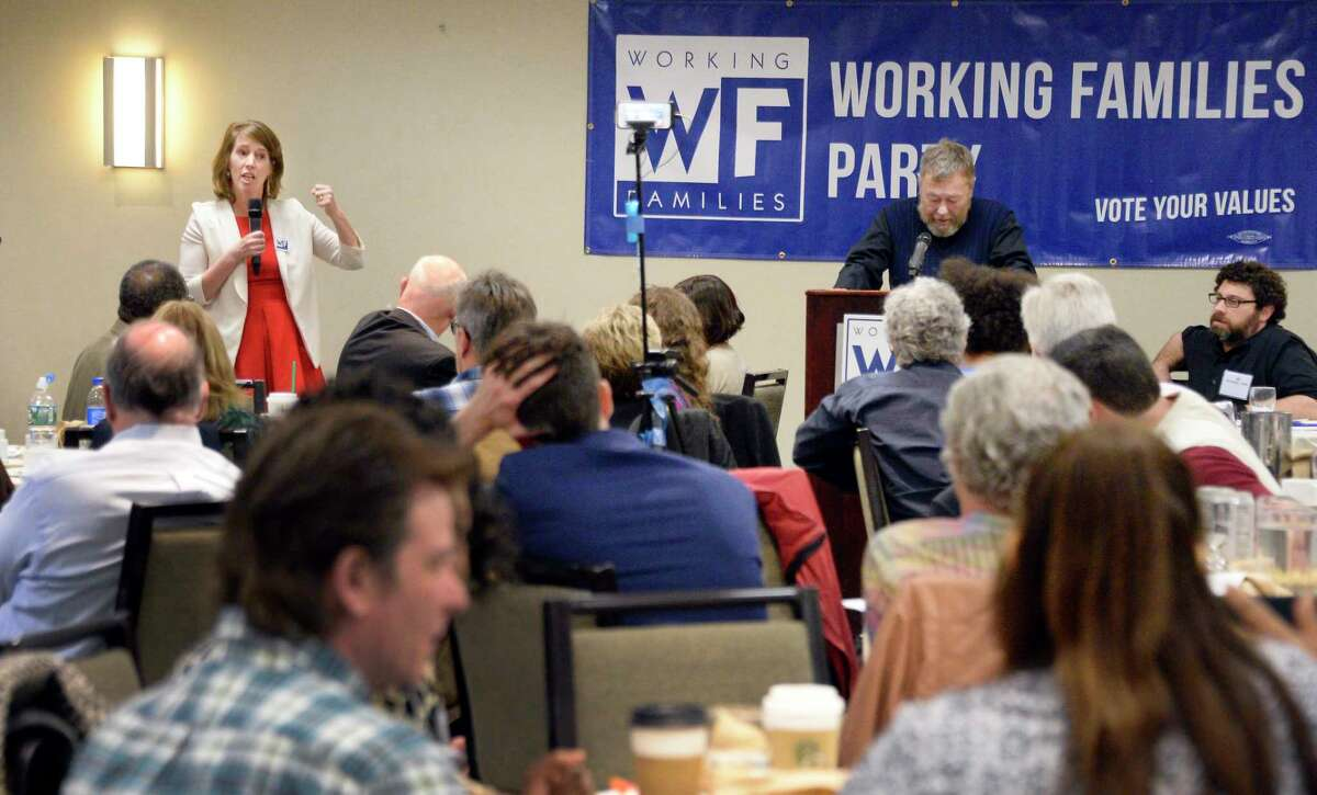 Zephyr Teachout, left, who campaigned in 2014 for the Democratic nomination for governor, endorses Cynthia Nixon for that office during a Working Families Party conference Saturday April 14, 2017 in Albany, NY. (John Carl D'Annibale/Times Union)