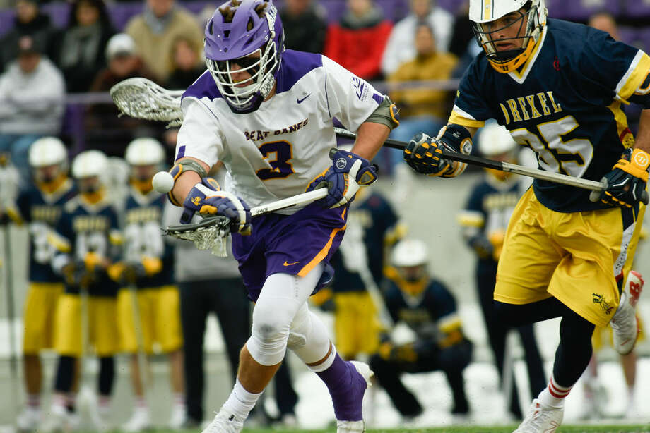UAlbany center TD Ierlan wins the ball at face-off with Drexel defender Brennan Greenwald during UAlbany's home opener on Saturday, Feb. 24, 2018, at Tom & Mary Casey Stadium in Albany, N.Y. (Jenn March, Special to the Times Union) Photo: Jenn March