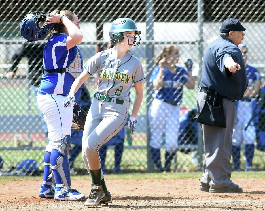 Hamden's Mackenzie Sargolini, center, crosses the plate with the go-ahead run in the bottom of the seventh inning against West Haven on Saturday. Photo: Arnold Gold / Hearst Connecticut Media / New Haven Register