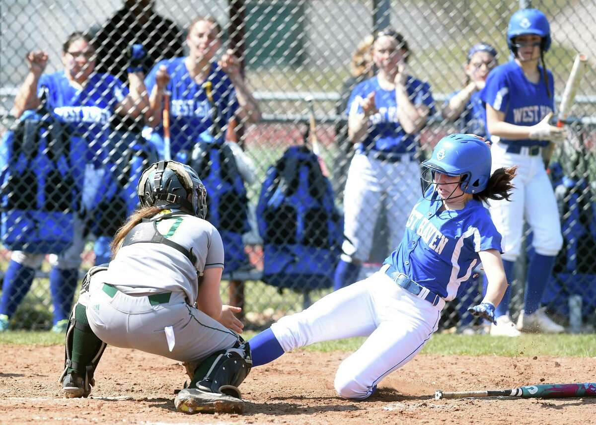 Hamden catcher Miranda Schlauder tags out West Haven pinch runner Gigi Perkins at the plate in the fifth inning on Saturday.