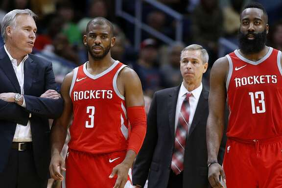 NEW ORLEANS, LA - MARCH 17:  Head coach Mike D'Antoni of the Houston Rockets, James Harden #13 and Chris Paul #3 talk during the second half against the New Orleans Pelicans at the Smoothie King Center on March 17, 2018 in New Orleans, Louisiana. NOTE TO USER: User expressly acknowledges and agrees that, by downloading and or using this photograph, User is consenting to the terms and conditions of the Getty Images License Agreement.  (Photo by Jonathan Bachman/Getty Images)