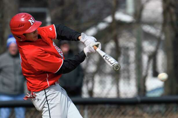 Niskayuna catcher Aaron Whitley hits a single during a game against Albany Academy in Albany, N.Y., on Saturday, Apr. 14, 2018. (Jenn March, Special to the Times Union)
