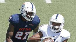 UTSA's Greg Campbell Jr. catches a pass as he is defended by UTSA's Teddrick McGhee during the eighth annual UTSA Football Fiesta Spring Game held Saturday April 14, 2018 at Farris Stadium.