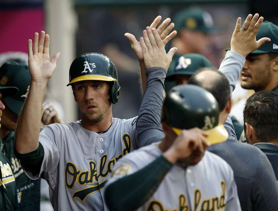 Oakland Athletics' Stephen Piscotty, left, celebrates scoring on a two-run single by Marcus Semien against the Los Angeles Angels during the second inning of a baseball game in Anaheim, Calif., Saturday, April 7, 2018. (AP Photo/Alex Gallardo) Photo: Alex Gallardo / Associated Press
